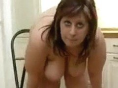 Obese chick with large mangos masturbates in the kitchen.