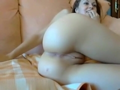Touching her shaved pussy on a webcam