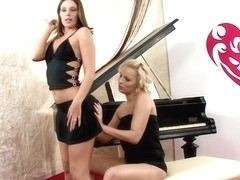 Debbie and Eve in Musical Seduction lick each other near the piano by Sapphic Erotica