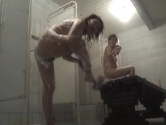Shower room spy cam video of sexy females in foam