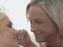 Teen lesbian lovers gently licking each other