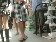 Awesome babe in extra short skirt getting filmed outside