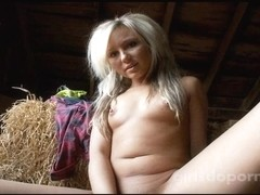 Blonde angel went into a barn to play with her toy