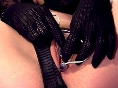 Closeup masturbation in fishnet nylons and gloves