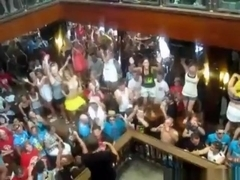 German girls dance in bikini on tables in a bar and flash their tits