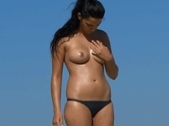 Voyeur compilation with big titted hotties on the beach