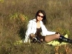 Zuzinka in a field teased by horny camera guy