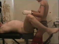 Domme belt-on copulates thrall in gyno chair
