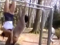 Upside down blowjob outdoors from an athletic girl