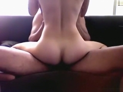 Asian girl with hairy pussy rides her bf on the sofa