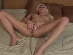 Mature blonde is alone today with her snatch
