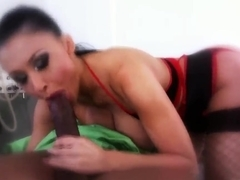 Aletta Ocean stripping and sucking a black cock in the darkness
