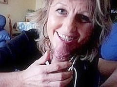 Amateur Smiles For The Camera While Giving Head