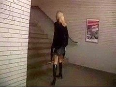 Blond exhibitionist stuffs her butt on the educate