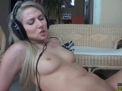 Blond wearing headphones during the time that having sex