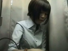 Chinese chick in changing rooms trying on silicone breast pads