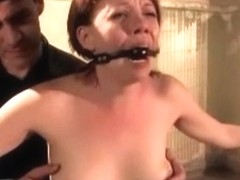 Redhead is shackled, whipped, and clamp