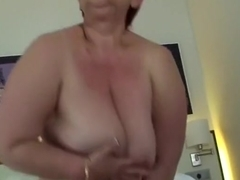 Red-haired mature slut with a massive butt masturbates like crazy