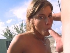 Amateur gal Nikki sucks dick on roof of house