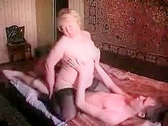 Mature large alluring woman with showing younger chap the ropes