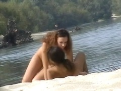 Hidden cams at the beach get two sexy naked Latina babes