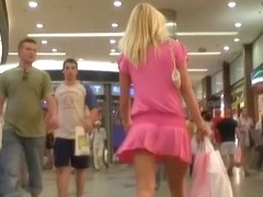 Sexy blonde in pink dress talking on cell phone