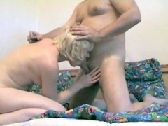Chunky boy getting oral sex from golden-haired wife