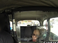 Babe with glasses sucks big dick in fake cab