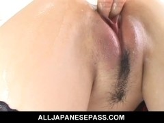 Lustful cougar Naami Hasegawa in fishnets teasing her snatch