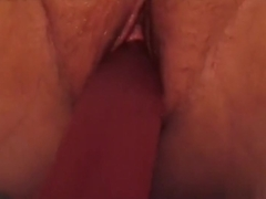 She loves her dildo. You can see at the end a little squirt from her pussy