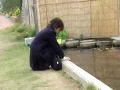 Inviting Japanese gal in a raunchy sharking video outdoors