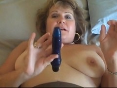 Grandma is masturbating in pantyhose