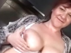 big beautiful woman aged in the kitchen