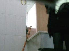 Candid camera video of a sexy asian schoolgirl pissing