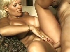 Hot mature golden-haired sucks a lengthy penis