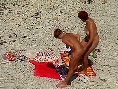 Two mature sluts naked on a beach