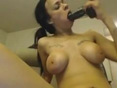 busty ebony toying with black toy