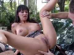 Busty tattooed milf Angie Noir gets licked outdoor