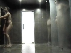 Sexy babe with long legs washes her tits on the spy camera
