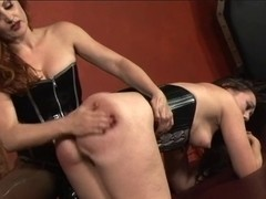 Breathtaking s&m lesbian babes in corsets play with strapons and sex tools in dungeon