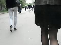 A hottie in black dominates this street upskirt video