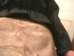 Upskirt scene with lady in short skirt, stockings and hessian boots