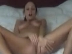 Hot beauty widens her legs and masturbating