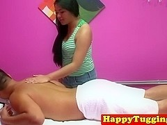 Asian masseuse jerking on her clients cock