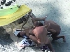 Pair lascivious on the beach caught fucking in 3some on hidden voyeur camera