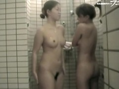 Asian girls are staying under the streams of shower water dvd 03241