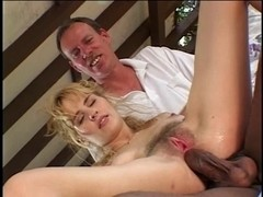 Soft c-cup blond kneels to engulf 2 darksome dongs then one as well as the other chaps fuck her sn.