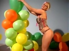 Angel Uses Her Sharp Nails to Pop Some Small Balloons