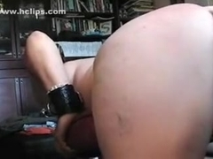slut fucked with wooden handle