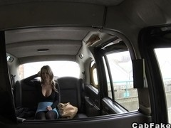 Busty brunette eats ass and fucks in fake taxi